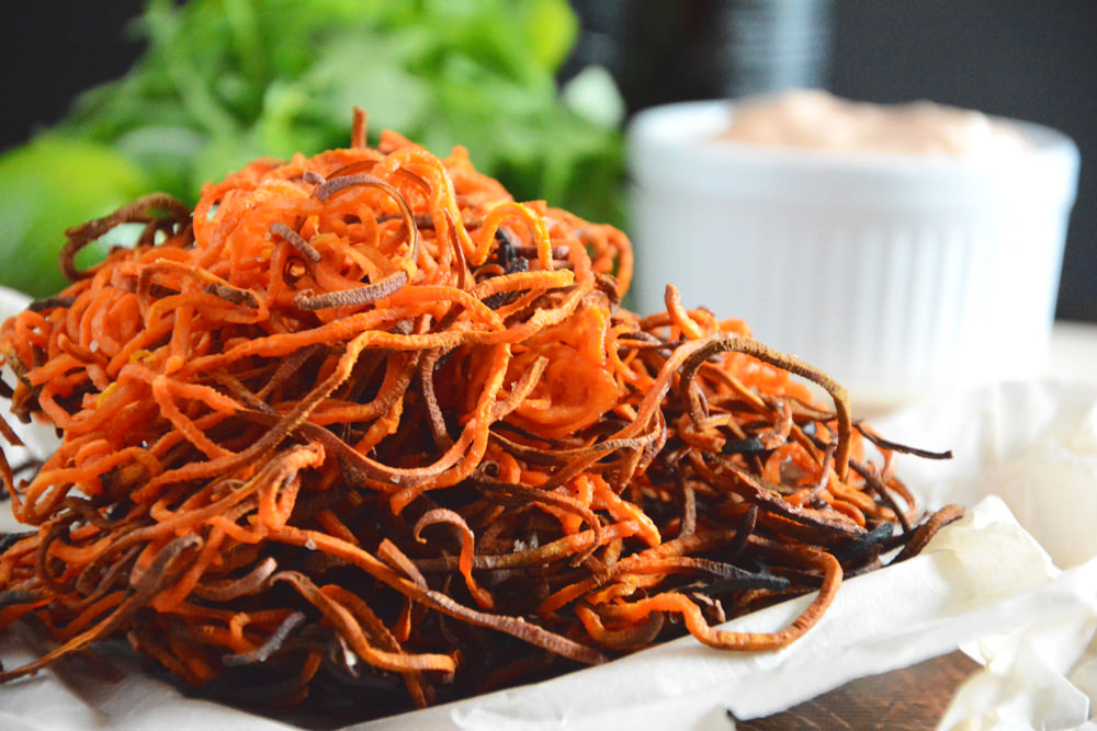 Homemade Sweet Potato Curly Fries with Chipotle Lime Aioli are a healthier spin off the classic sweet potato fry. Crispy, sweet, spicy and irresistible! #paleo #healthier #spiralized #fries