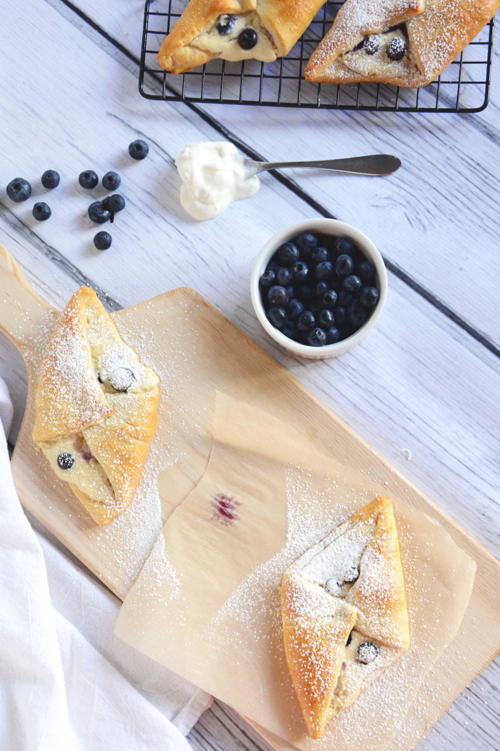 Buttery and flakey croissants filled with whipped honey cream cheese and tart blueberries are the perfect breakfast!