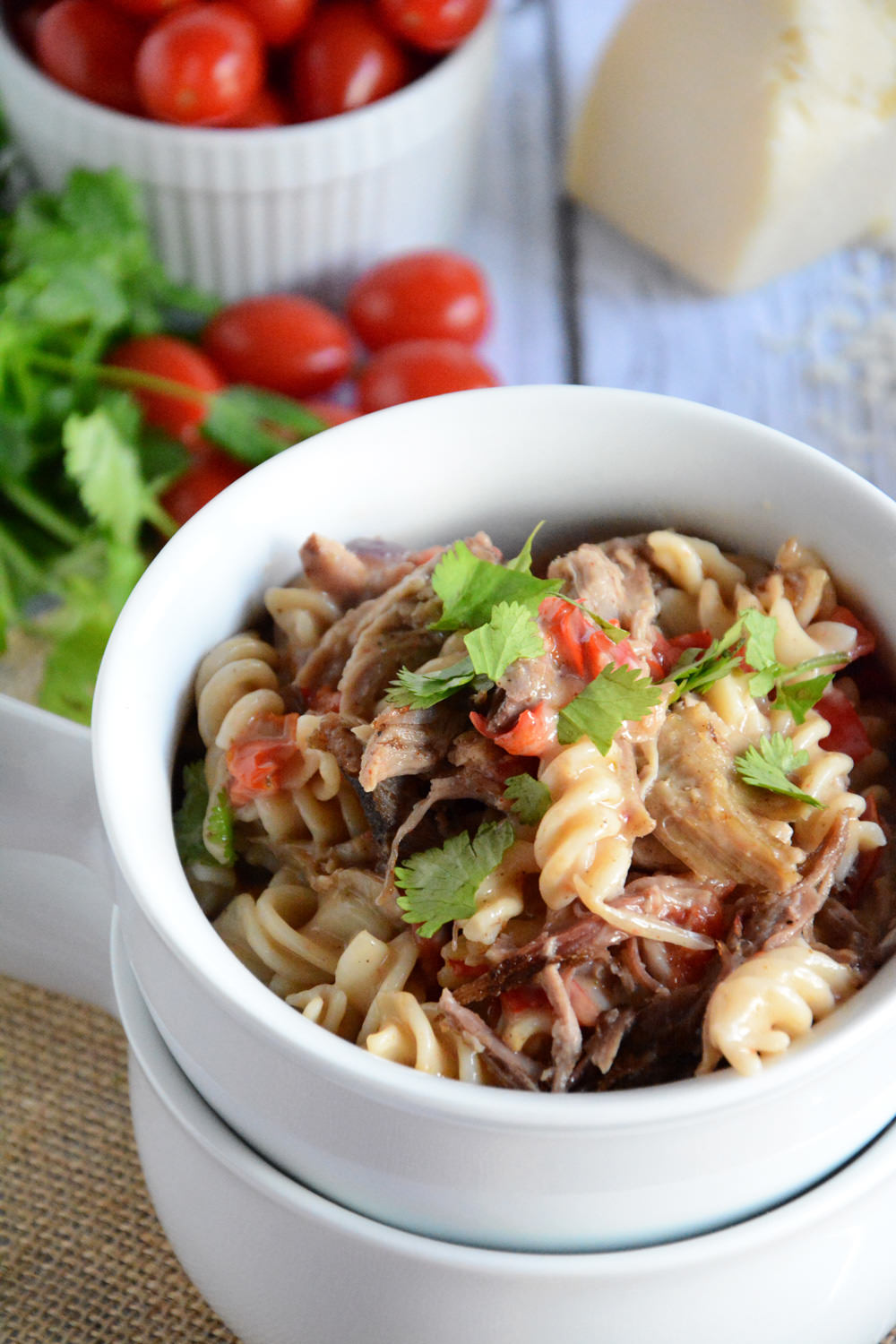 A creamy cajun alfredo sauce that comes together in minutes and topped with pulled pork is a quick and healthy dinner! #pasta #glutenfree #BBQ