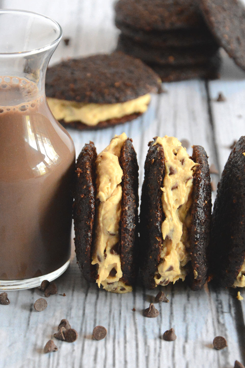 Cookie Dough Stuffed Whoopie Pies are a guiltless treat with a chocolate cookie and stuffed with cookie dough that only seems sinful!