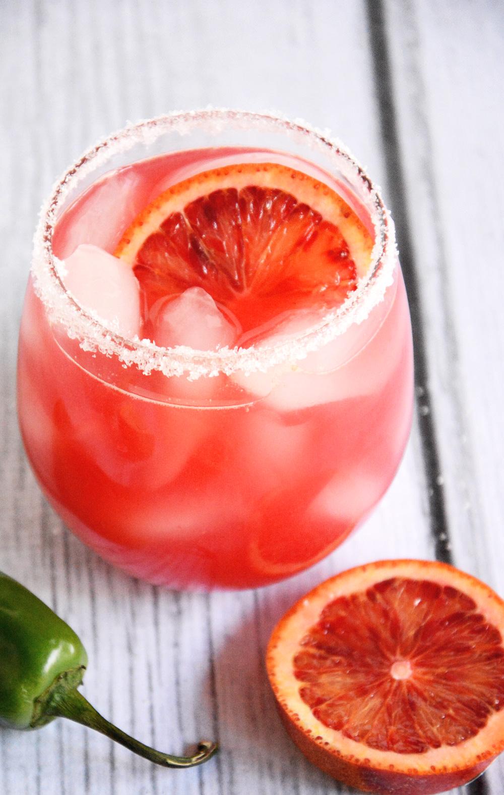 This Blood Orange Margarita Recipe is a refreshing twist on a classic margarita with fresh blood orange juice, triple sec, and fresh lime juice!