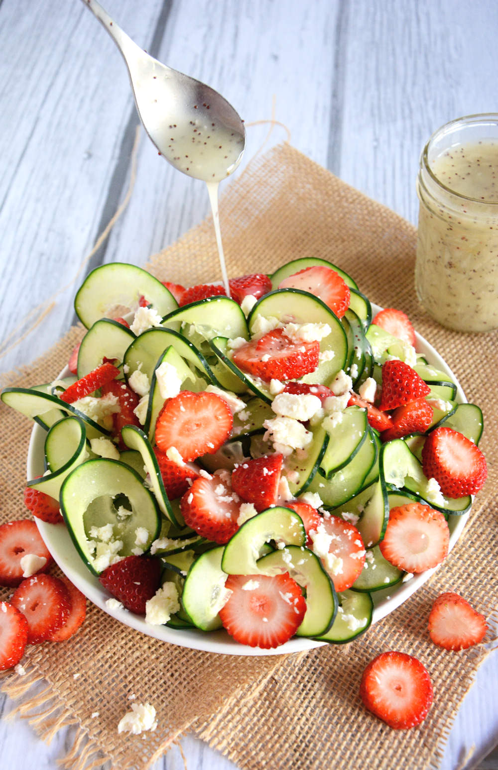 A refreshing and crisp salad with spiralized cucumbers, juicy strawberries and feta salad all topped with a fruity poppyseed dressing!