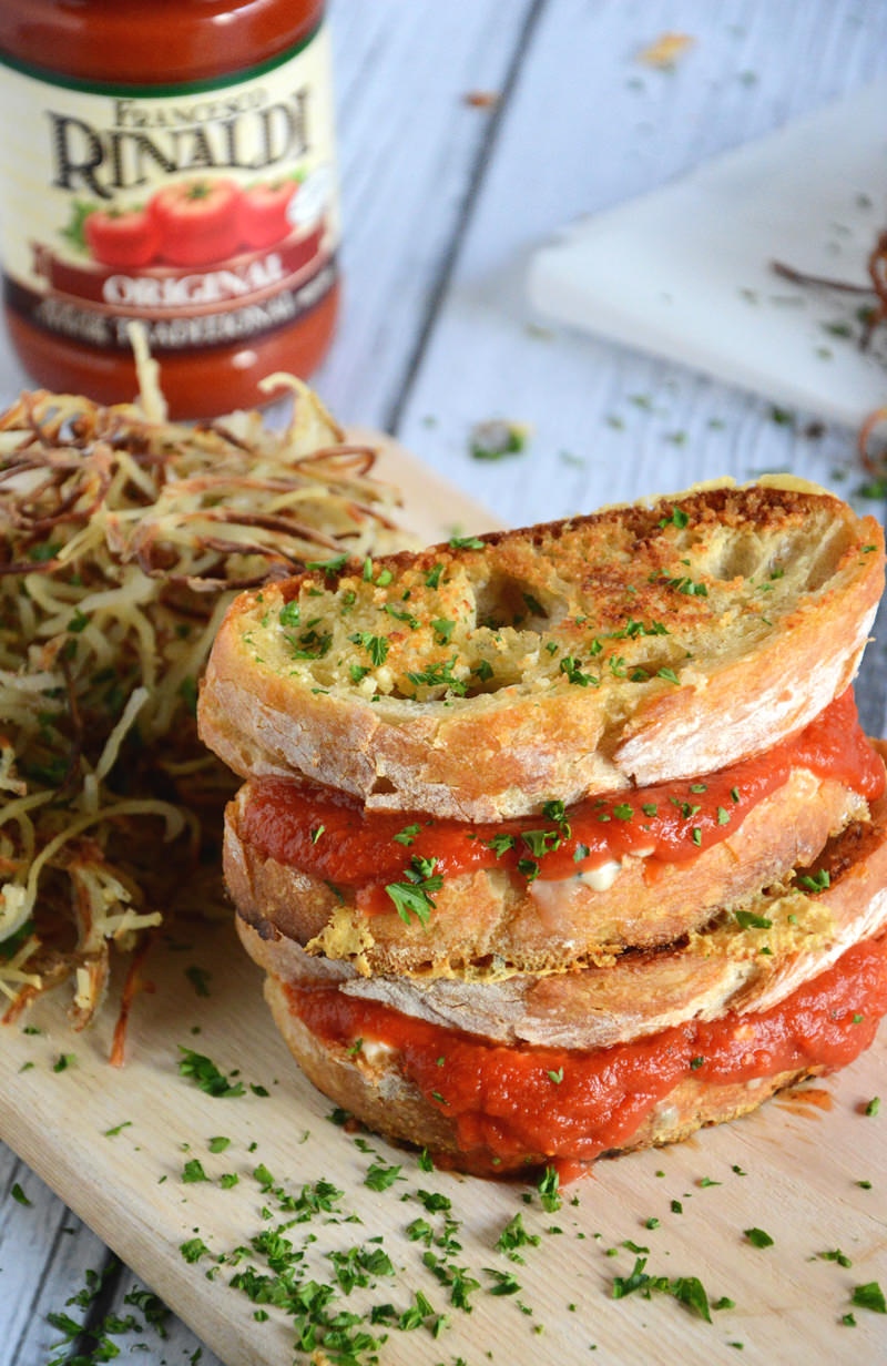 A gooey triple grilled cheese filled with two cheeses and warm marinara sauce with a crunchy parmesan crust!