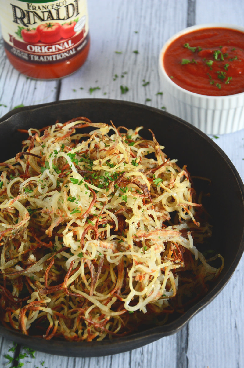 Extra crispy curly fries made, with a spiralizer, are loaded with garlicky goodness and perfect side dish for any burger!