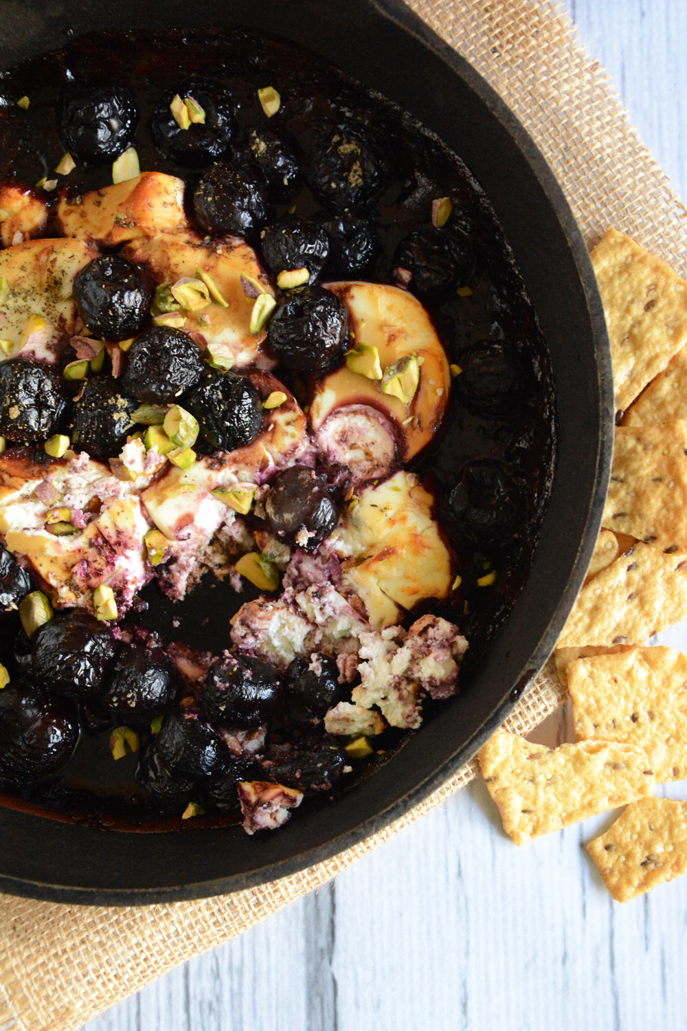 A simple fundido style appetizer with creamy goat cheese, tart cherries, balsamic drizzle, honey and pistachios that will go from oven to table in a matter of minutes!