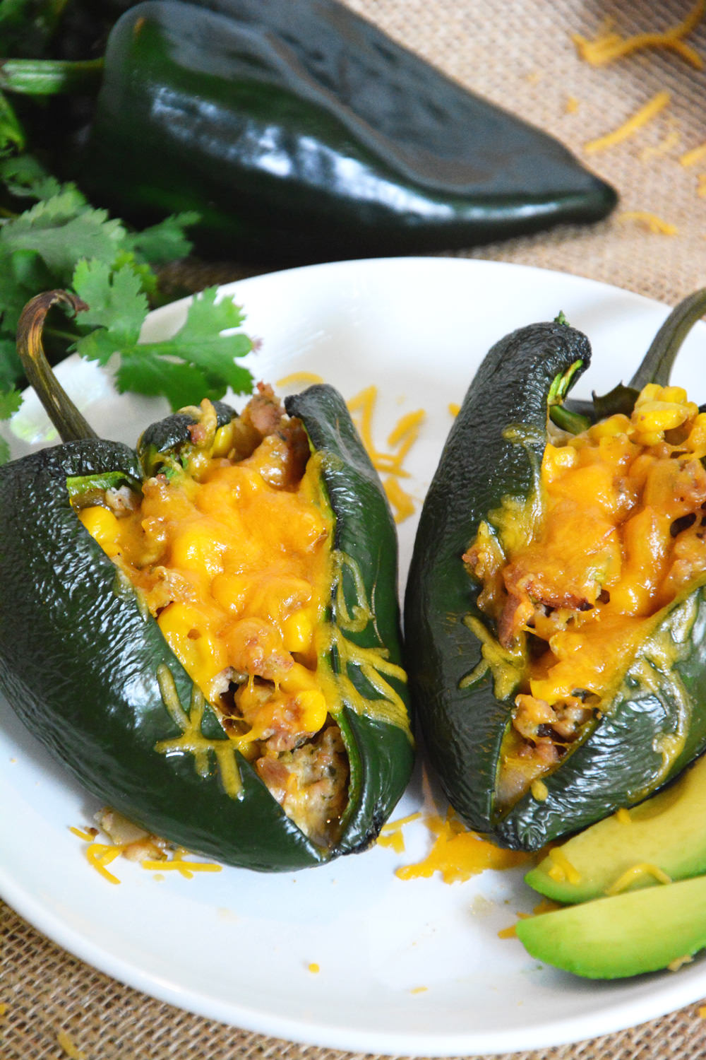 Stuffed poblano peppers loaded with flavorful chicken sausage, green chiles and fresh corn to make one nutrient dense meal!