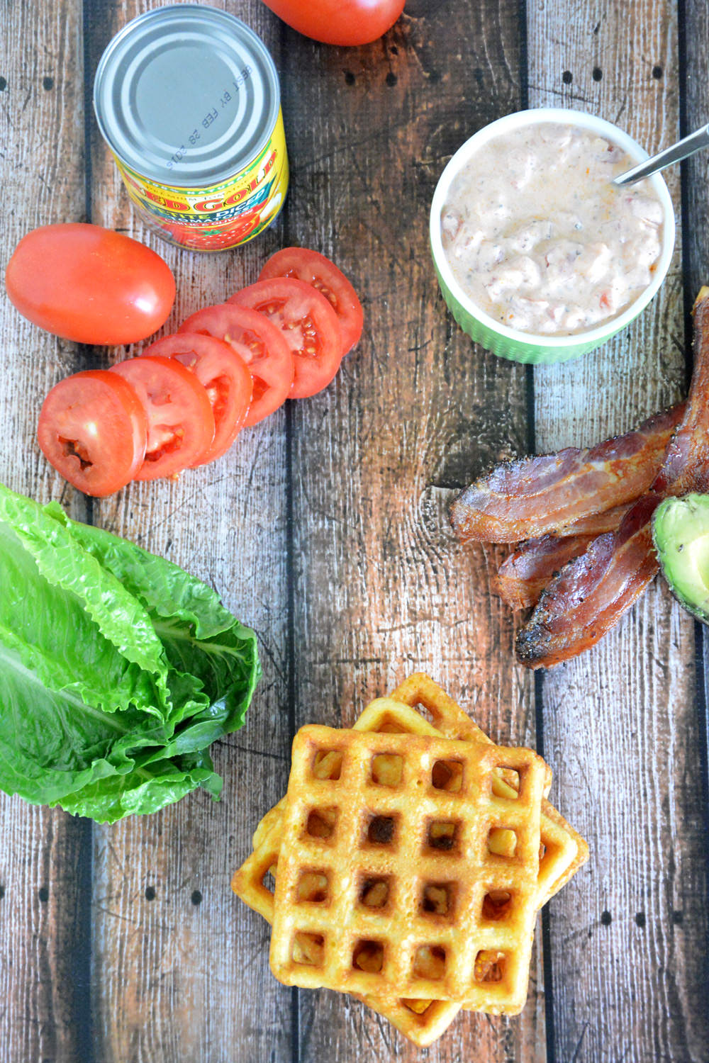 Cornbread Waffle BLT's with Garlic Aioli  are crispy and sweet cornbread waffles, layered with smoky bacon, fresh lettuce, creamy avocado and garlic aioli for a delicious twist on the classic BLT!