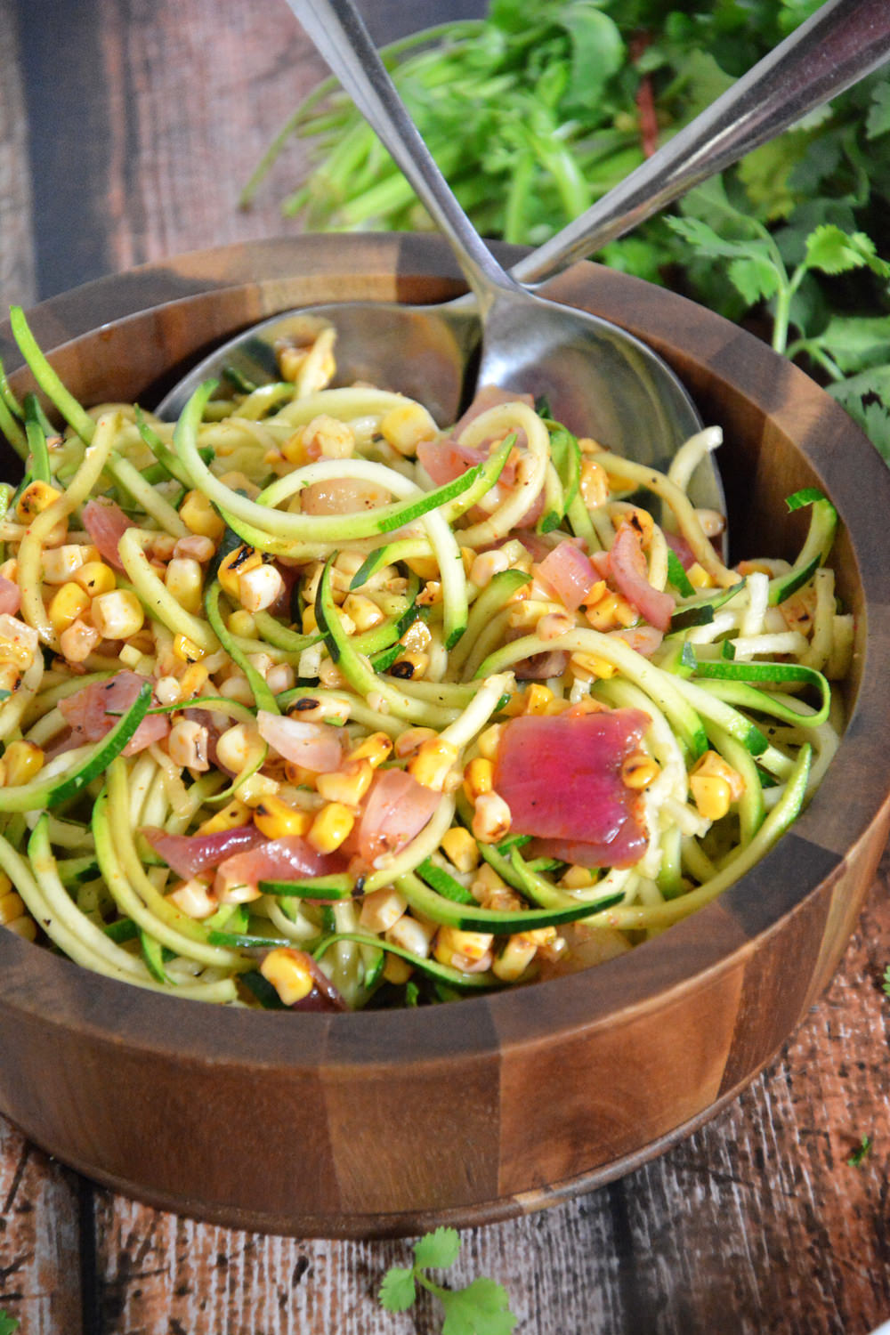 Roasted corn is paired with spiraled zucchini, red onion & tossed with a simple chili lime vinaigrette for a fresh, make ahe