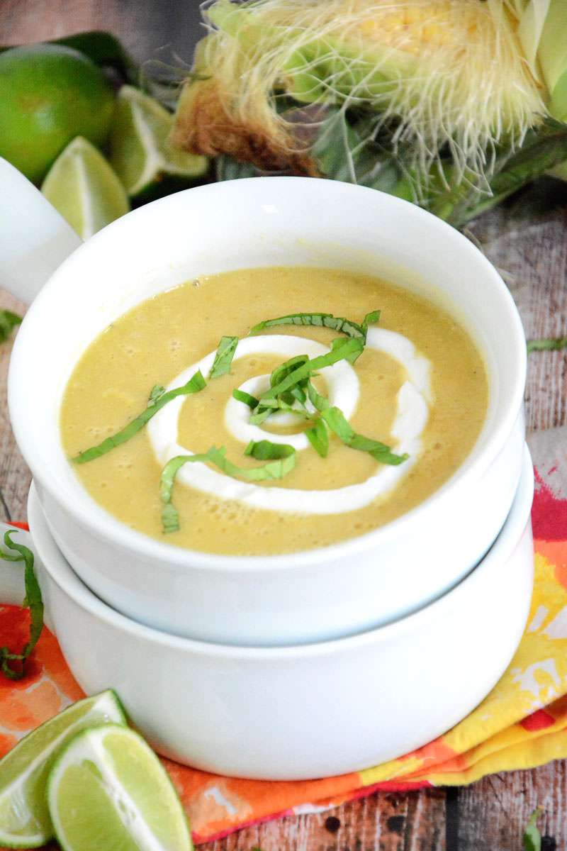A creamless corn soup made with of a sweet corn puree with a lime crema and basil. Thrown together in one pot and have dinner on the table in under 30 minutes! #glutenfree #healthy #soup