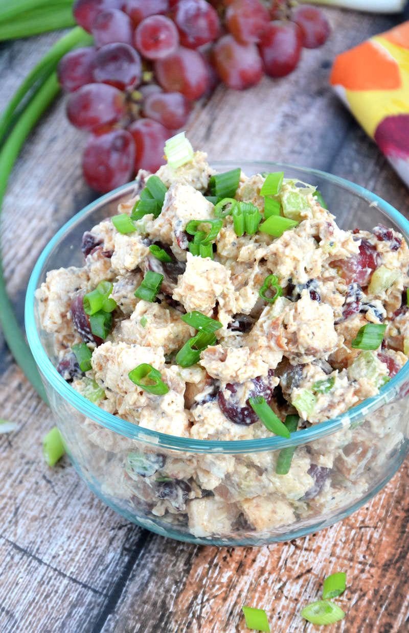 A sweet and smoky chicken salad, made lighter with greek yogurt, cranberries, celery and grapes that pairs wonderful with a croissant, whole grain wrap or with lettuce for a guilt free meal! #skinny #glutenfree #highprotein #lowcarb