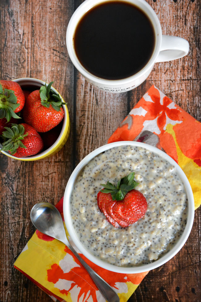 Start your day with a bowl of oatmeal that tastes like a Strawberry Shortcake! Nutty oats, strawberries and a hint of vanilla all come together quickly for a dessert inspired breakfast! #proteinoatmeal #breakfast #strawberryshortcake #glutenfree