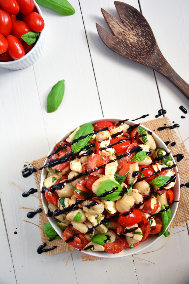 Caprese Salad gets made over and tossed with delicious gnocchi for an easy and wholesome, make ahead salad! #pastasalad #gnocchi #caprese #pasta