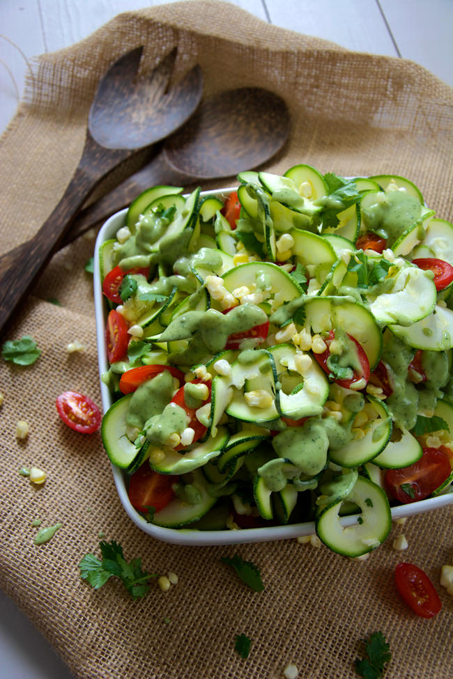 Fresh sweet corn, juicy cherry tomatoes and spiralized zucchini noodles are mixed and topped with a three ingredient dressing of creamy avocado, ranch seasoning and almond milk! A simple, raw salad that makes the most of end summer ingredients!