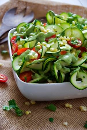 Fresh sweet corn is mixed, juicy cherry tomatoes and spiraled zucchini noodles are topped with a three ingredient dressing of creamy avocado, ranch seasoning and almond milk! A simple, raw salad that makes the most of end summer ingredients!