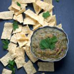A simple salsa verde of roasted tomatillos, red onions and hatch chiles to make a sweet and smoky salsa that is perfect to any salty tortilla chip!