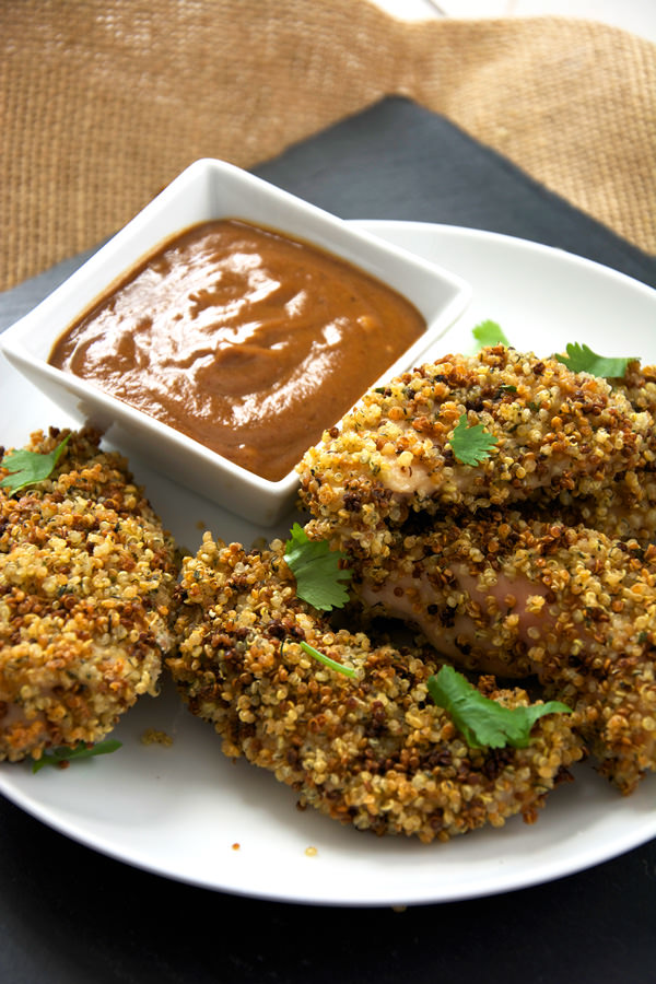 Chicken Fingers made over by encrusting in ranch seasoned quinoa for major crunch! And served with a two ingredient sauce of BBQ and mustard make for one delicious dinner!