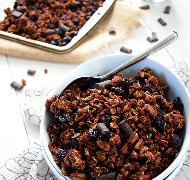 A lighter granola made with unsweetened applesauce and honey! Dark chocolate chunks, cherries and pecans make this skinny granola a decedent treat!