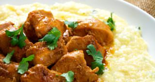 Spicy Sriracha Chicken over Goat Cheese & Roasted Poblano Grits