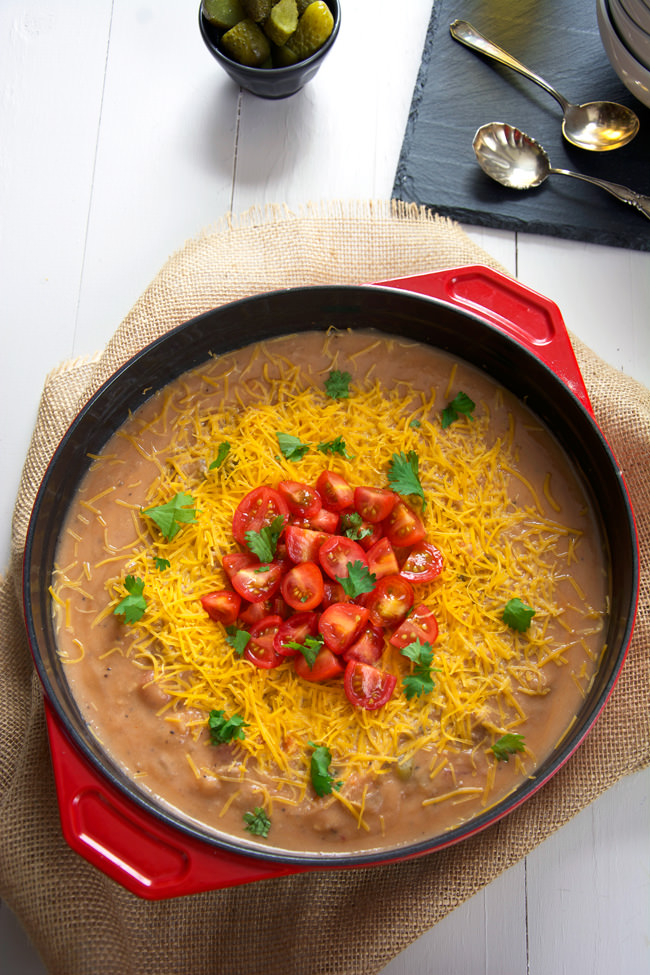 All the flavors of a juicy burger and loaded baked potato soup in one bite in this ultra creamy, delicious and lighter recipe! #potatosoup #soup #healthy #cheeseburger
