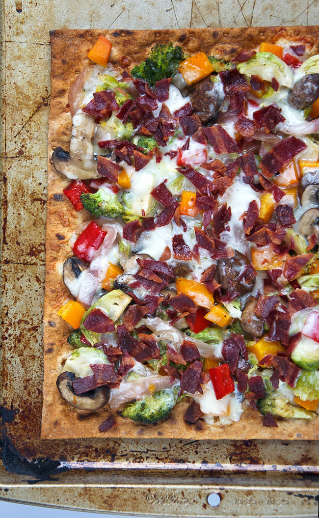 ... roasted veggies, crispy bacon and creamy fontina for a flatbread that