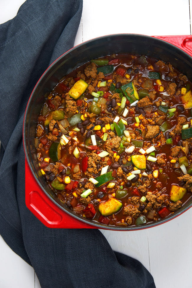 A vegetable loaded, spicy chili made with homemade turkey chorizo that sits in a bed of creamy, pepperjack polenta! #chili #chorizo #polenta #glutenfree