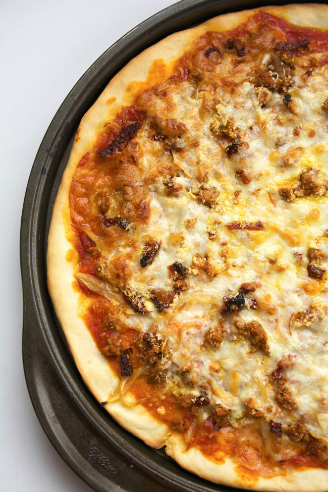 A sweet and savory pizza topped with buttery, caramelized onions, juicy sun dried tomatoes and spicy chorizo! All topped with not one, but two velvety cheeses!