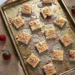 Two classic cookies come together in this lighter and sweet shortbread sugar cookie! And drizzled with a simple strawberry toffee glaze; they will be a hit this holiday season!