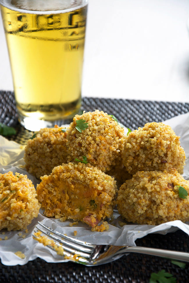 All the flavors of a loaded baked potatoes but lightened up with sweet potatoes, turkey bacon and buttery gouda then rolled into crispy quinoa for a major crunch!  These Quinoa Encrusted Loaded Sweet Potato Bites will be the hit during any tailgate!