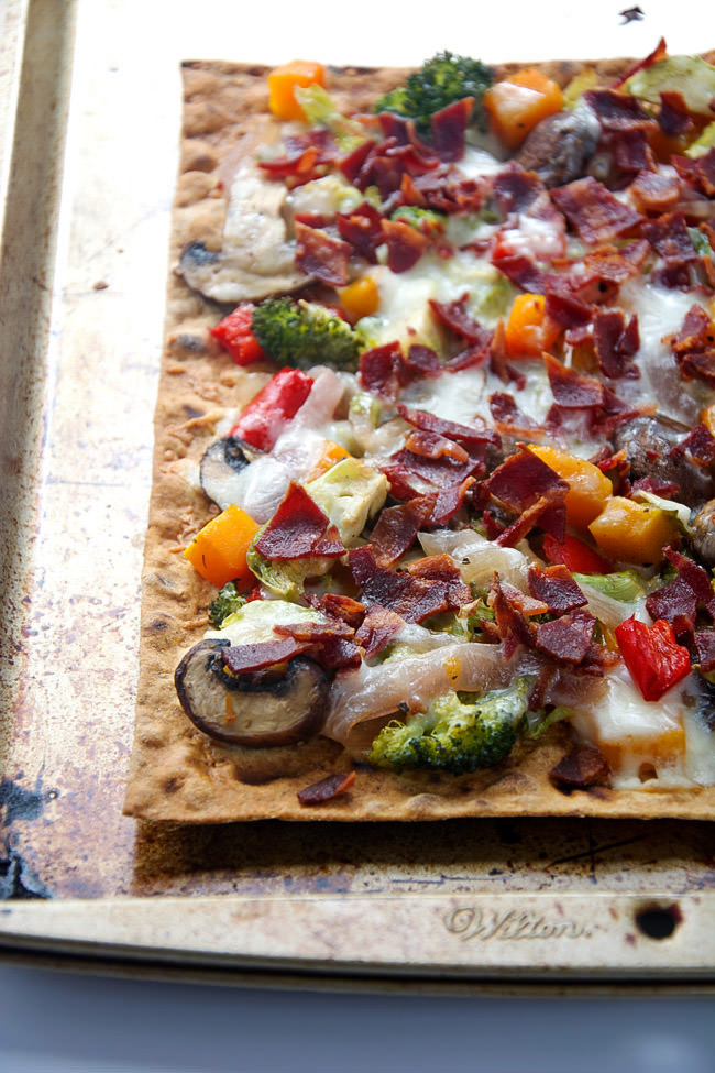 Thin and crispy lavash is used as the base for this flatbread, then topped with autumn, maple roasted veggies, crispy bacon and creamy fontina for flatbread that will please anyone!