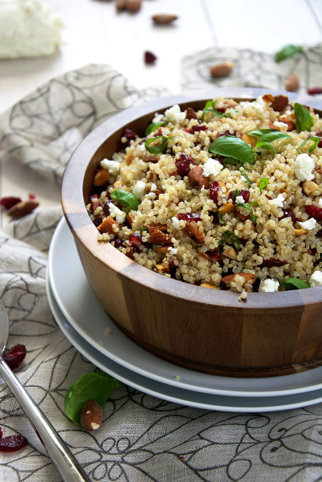 A simple, make ahead quinoa salad filled with tart cranberries, smoked almonds, basil, creamy goat cheese and finished off with a homemade balsamic vinaigrette!  #quinoa #salad #glutenfree