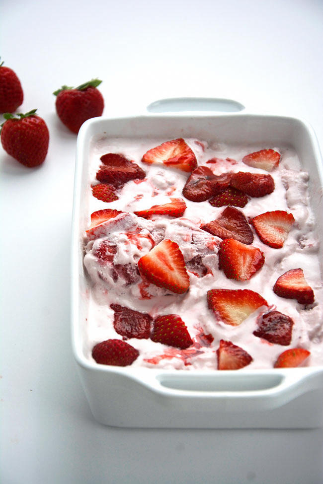 Creamy cheesecake ice cream made lighter with coconut and almond milk, and stuffed with caramelized, roasted strawberries for one heavenly frozen dessert!  #icecream # dessert #strawberries #cheesecake