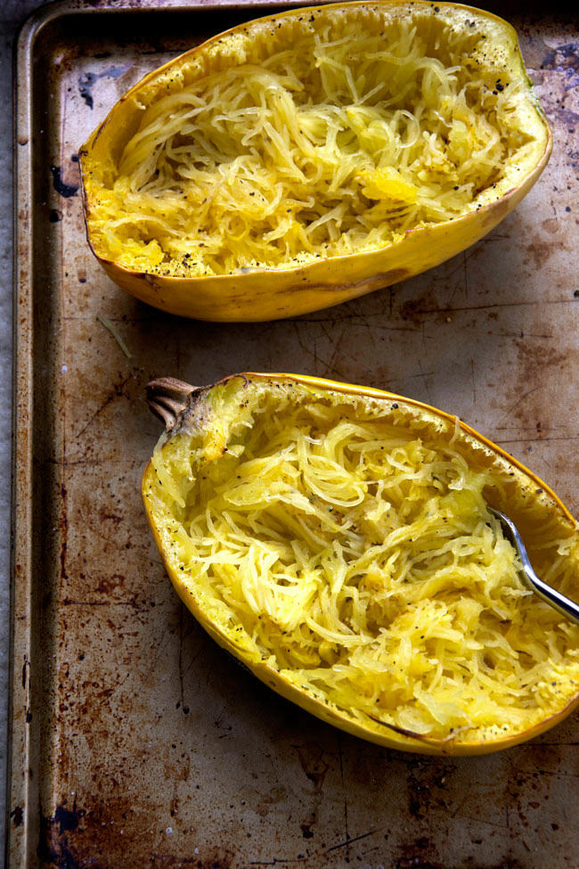 Stuffed spaghetti squash filled with a lightened up version of a favorite dip - spinach and artichoke! A super simple, yet healthy dinner that perfect any night of the week!