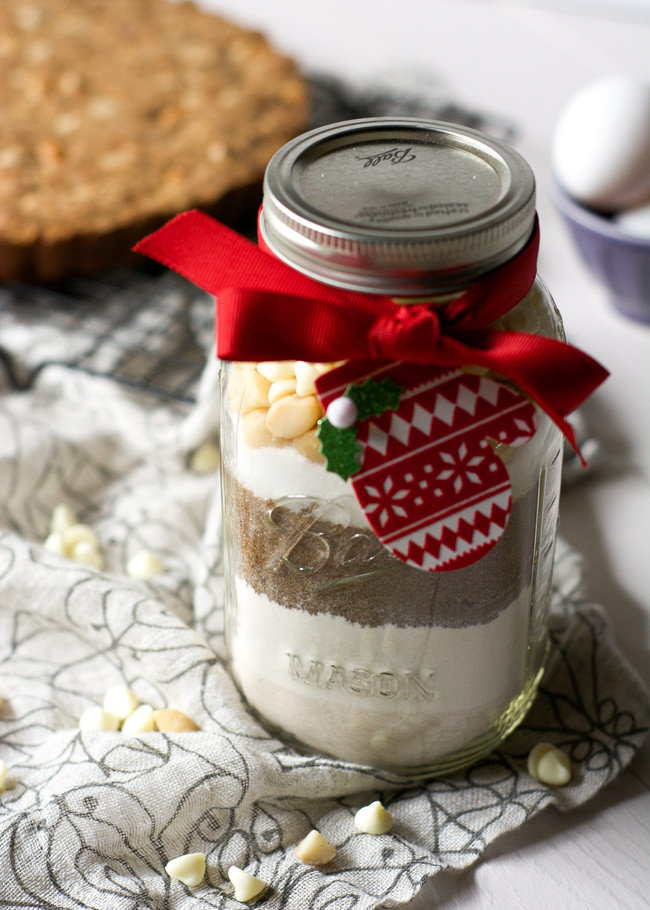 Whole Wheat White Chocolate Macadamia Cookie Cake in a jar is the perfect unique gift so everyone can enjoy a straight from the oven cookie anytime!