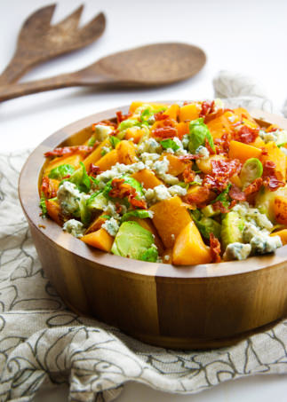 Sautéed Brussels Sprouts & Butternut Squash topped with buttery prosciutto and salty blue cheese for a simple and quick side dish or a vegetable focused main dish! #salad #glutenfree #paleo