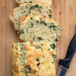 A lighter, savory parmesan bread with buttery prosciutto and fresh kale. The perfect cheesy bread that is perfect for the holiday season and compliments any dinner!