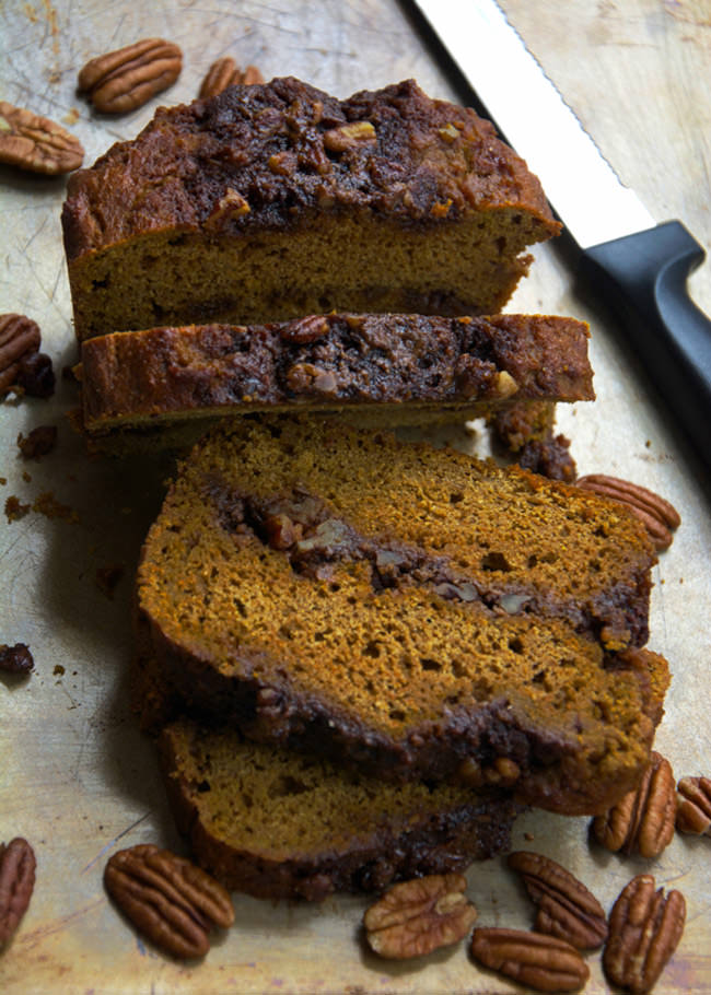Healthier Double Crumb Cinnamon Roll Pumpkin Bread is moist and filled with a double sugary cinnamon roll filling! It is the best of both worlds that is easy to make, delicious and guilt free! #pumpkinbread #cinnamonroll #coconutoil #healthy