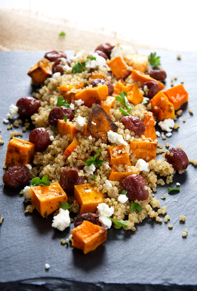 This Butternut Squash Quinoa Salad is a delicious and flavorful quinoa salad made of caramelized butternut squash, creamy goat cheese, roasted grapes, and basil! Make ahead and store in the fridge until ready to serve!