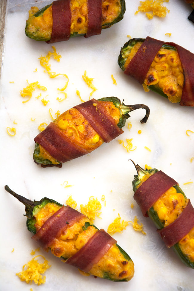 Cheesy Corn Stuffed Jalapenos will help you get out of that game day grub rut! Cheesy cornbread is stuffed into jalapenos, wrapped in turkey bacon then baked! Surprisingly healthy and completely irresistible! #appetizer #stuffedjalapenos #cheesycorn #glutenfree