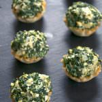 Mini tarts pays homage to the classic Spanakopita! These fool proof Creamy Spanakopita Tarts fill mini phyllo tarts with a lighter spinach and feta filling. They will be they hit at any party!