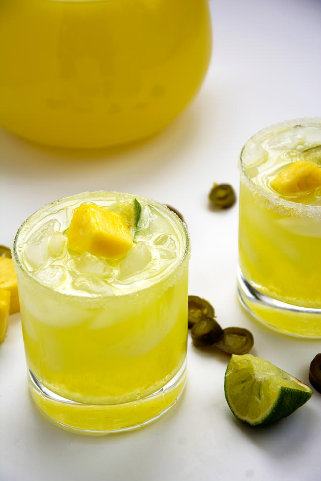 Skinny Jalapeño Pineapple Margaritas are makeover with homemade spicy simple syrup, fresh pureed pineapple and light lemonade!