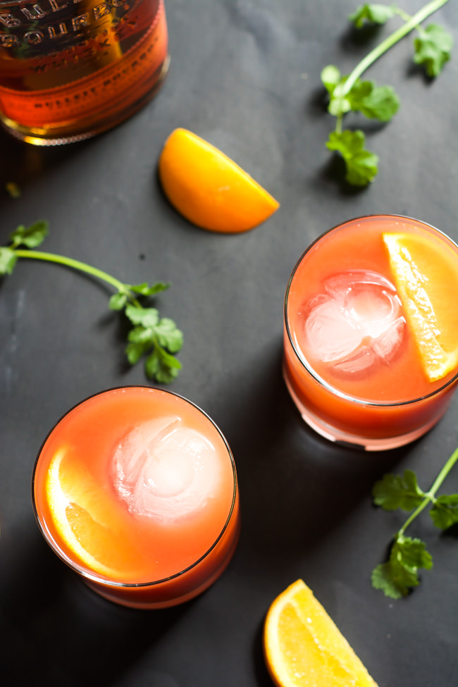This Blood Orange Bourbon Sunrise is a sweet and sour cocktail that is spiced with smooth bourbon, fresh blood orange juice and a touch of honey! #cocktail #drink #bourbon #whiskey