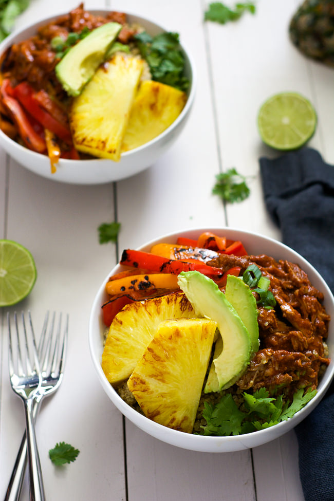 Slow Cooker Hawaiian Pork Burrito Bowls are a dinner saver as they cook all day in a homemade enchilada sauce then topped with sautéed peppers and juicy, seared pineapple!