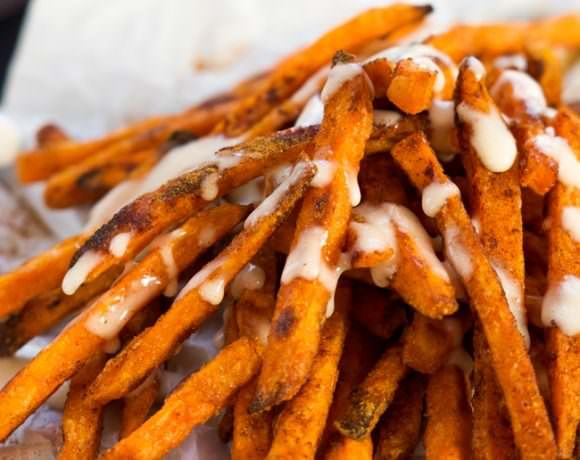 Cinnamon Sugar Sweet Potato Fries are cinnamon and sugar dusted and served with a homemade toasted marshmallow sauce! They are not your typical side of fries, rather a upgraded dessert! #sweetpotatofries #marshmallows # #GameTimeGrub