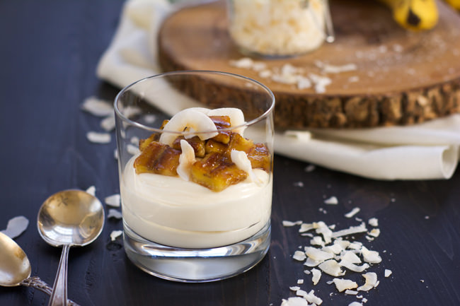 Skinny Banana Fosters Cheesecake Parfaits are madeover with cheesecake flavored greek yogurt, caramelized bananas and toasted coconut for a healthy, dessert inspired breakfast!