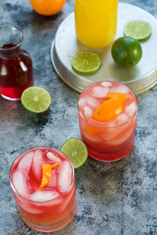 This Skinny Hurricane Cocktail is a healthier version of the classic Mardi Gras drink is filled with orange and cranberry juice and finished with light rum for a refreshing cocktail! #MardiGras #Skinny #Cocktail #Beverage