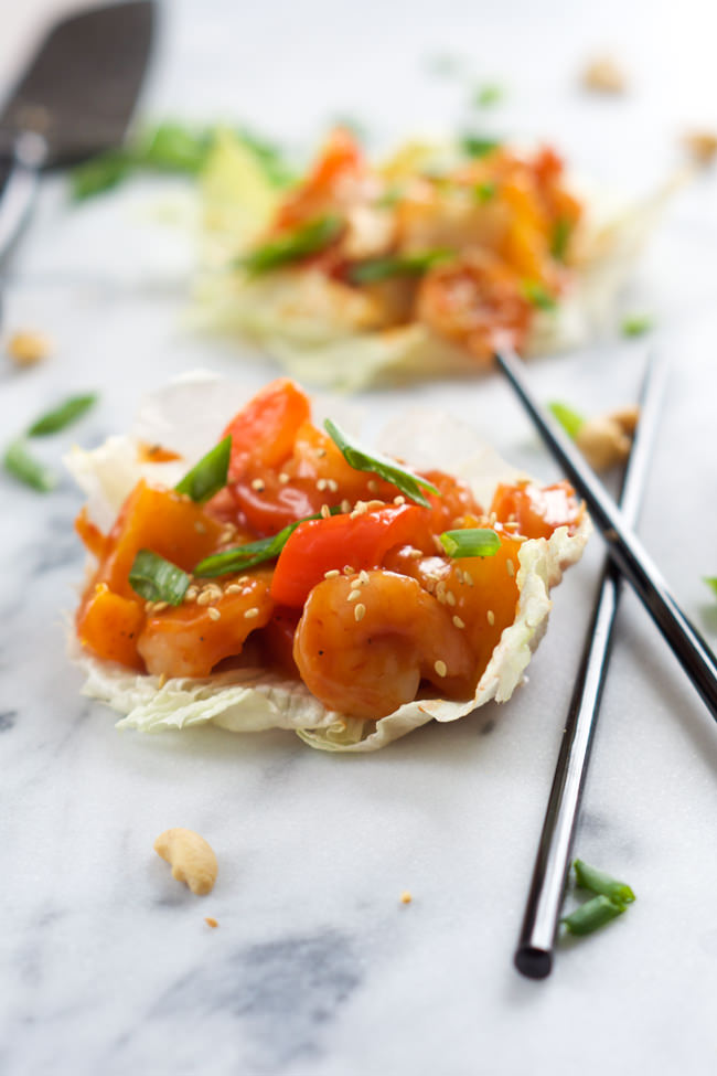 A healthy takeover make over! Skinny Sweet and Sour Shrimp Lettuce Wraps are full of Asian flavors, lighter and ready quicker than you can call take out! #Chinese #SweetandSour #LettuceWraps #glutenfree