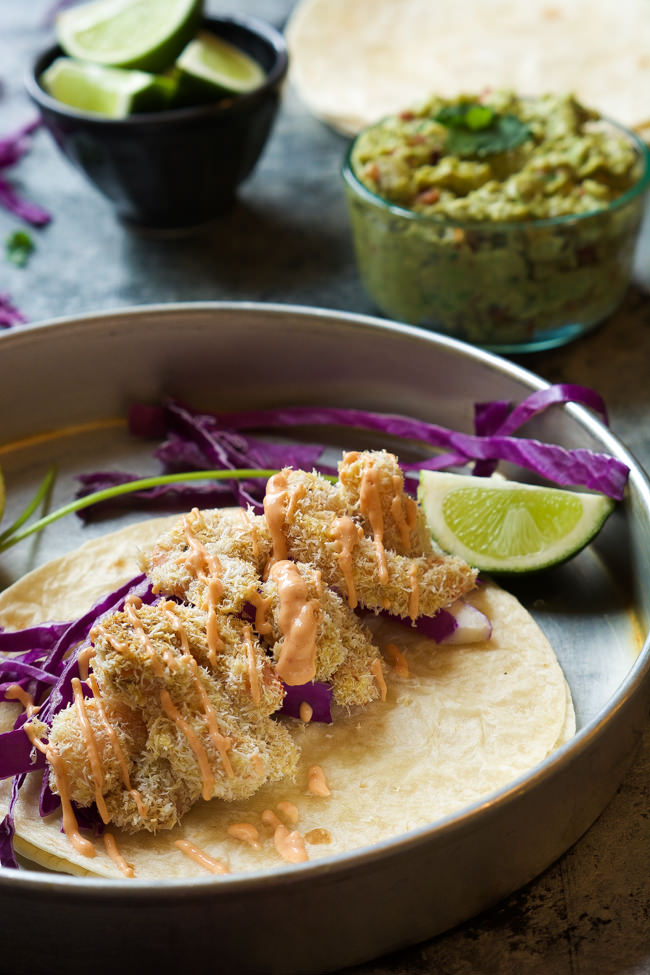 A skinny makeover of a restaurant classic! Skinny Baked Bang Bang Shrimp Tacos combine two of my favorites into one flavorful dish that is ready in 20 minutes!