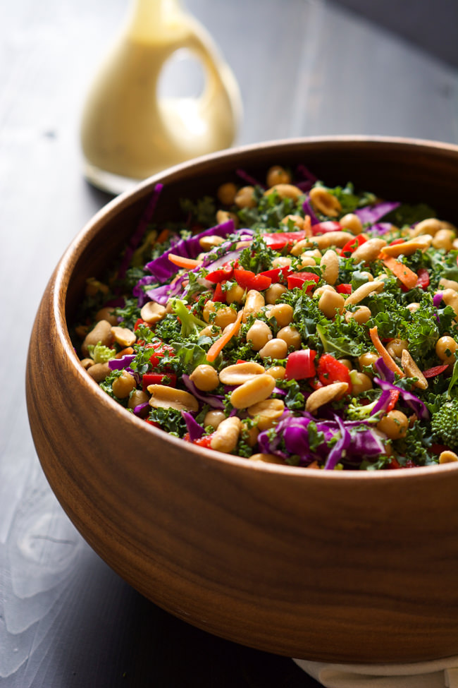 This colorful and nutrient dense Power Kale Salad is filled with crunchy vegetables, drizzled with a peanut dijon dressing and topped with salty peanuts! The perfect salad to fuel you up!