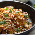 A sweet and spicy take on the classic! BBQ Chicken Sweet Potato Nachos combine two favorites! With gooey cheddar on top, this meal comes together quickly!