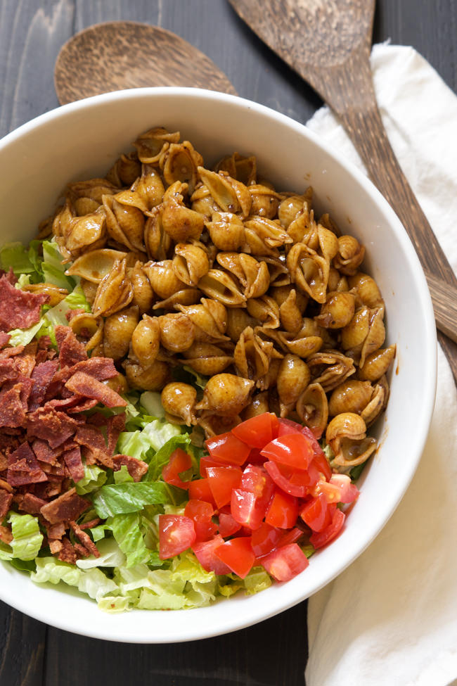 A favorite sandwich gets a pasta salad makeover! BLT Pasta Salad is a combination of bacon, tomatoes and lettuce with avocado added for one flavorful dish!